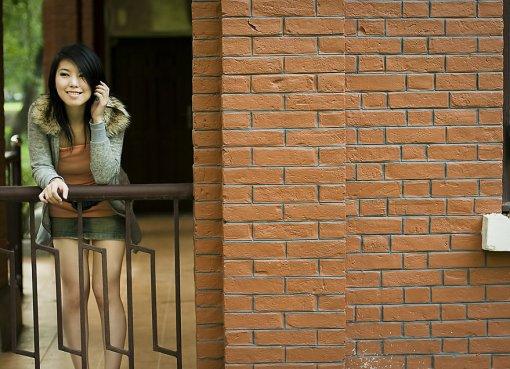 Beautiful Chinese girl posing on a railing