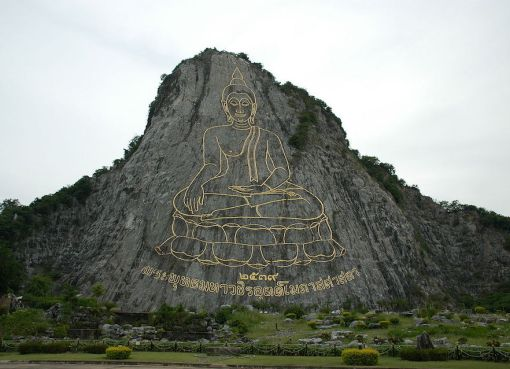 Silhouette of Buddha on the side of Khao Chichan in Chonburi