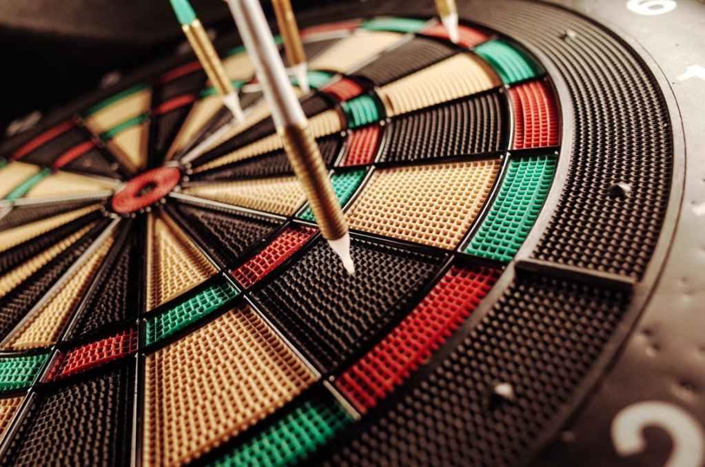 Four darts on a dartboard