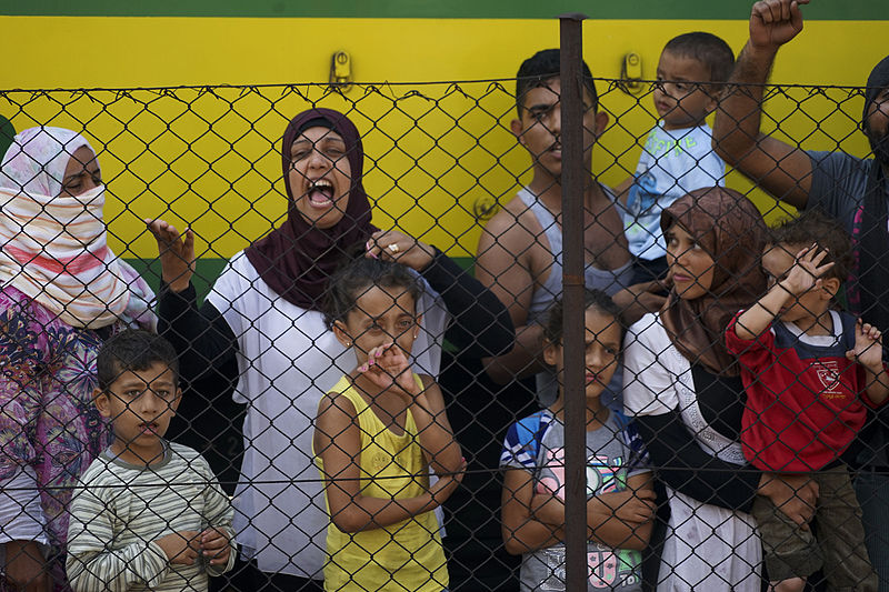 'Syrian refugees' striking at the platform of Budapest Keleti railway