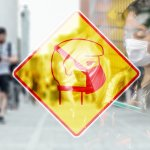 Yellow and red face mask symbol sign