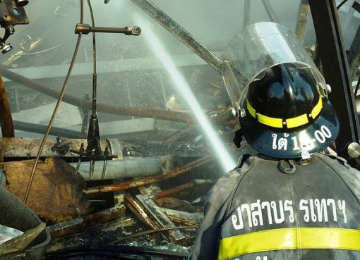 Thai firefighter spraying water