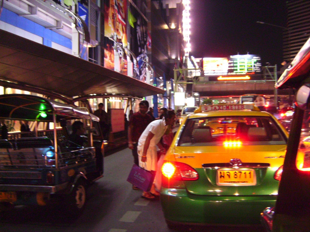 Foreigners taking a taxi in Bangkok