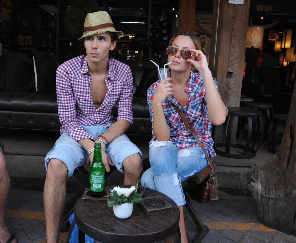 Foreign couple sitting down in Bangkok