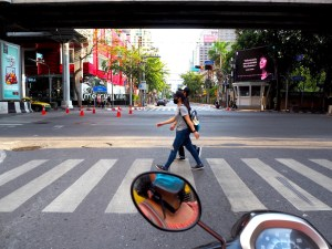 Girls wearing masks on a crosswalk in Bangkok during the COVID-19 pandemic