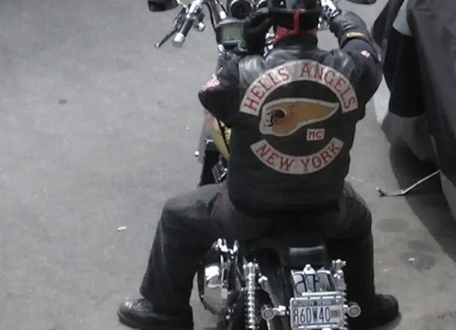 A member of the The Hells Angels Motorcycle Club (HAMC), whose members typically ride Harley-Davidson motorbikes