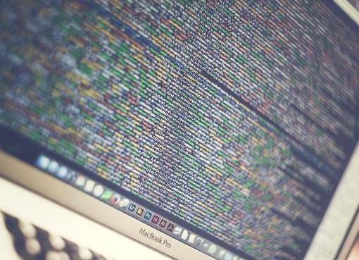 MacBook Pro displaying lines of code