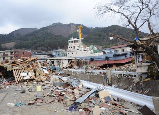 A tug boat is among debris in Ofunato, Japan