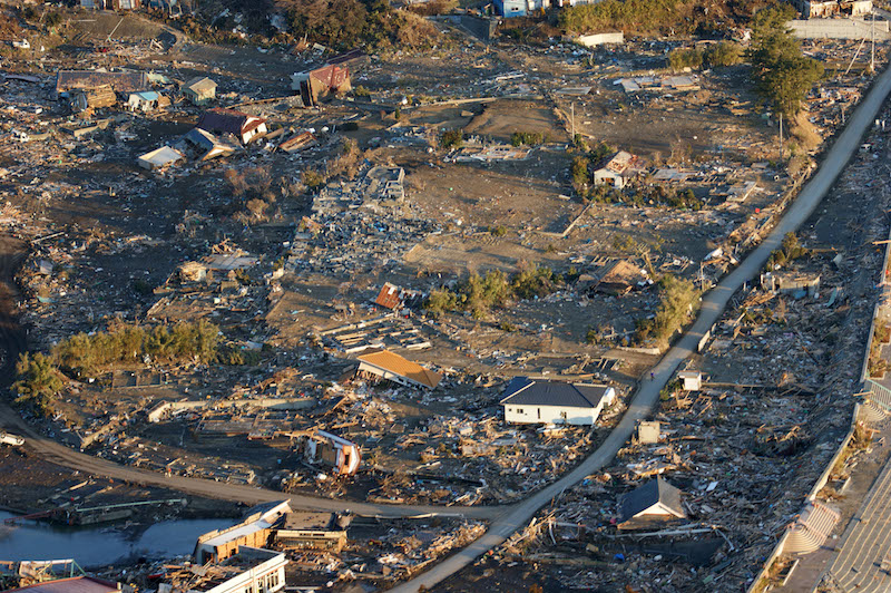 An aerial view of damage to northern Honshu, Japan, after a 9.0 magnitude earthquake and subsequent tsunami