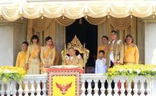 Thailand's HM King Bhumibol Adulyadej, center, is surrounded by his family members