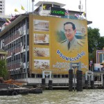 Image of His Majesty King Bhumibol Adulyadej on a pier in Bangkok