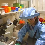 Doctor in the laboratory with a biological fluids tube for analysis and sampling of virus
