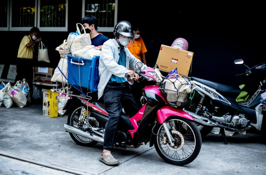 A man rides a motorbike in Bangkok during the COVID-19 pandemic