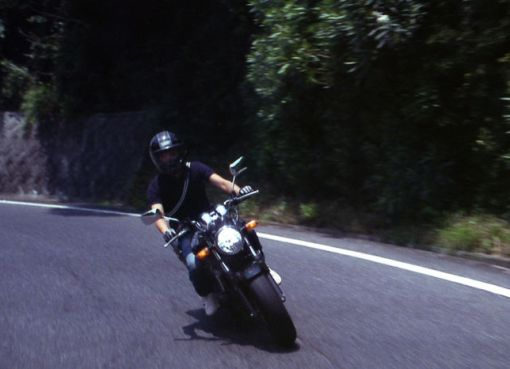 Man Riding a motorbike on the road