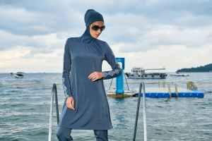 Muslim woman wearing a burkini.