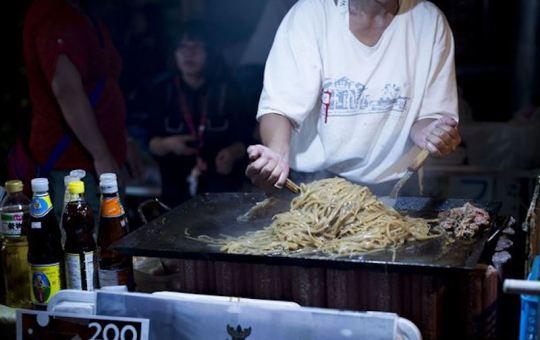 Street vendor cooking noodles
