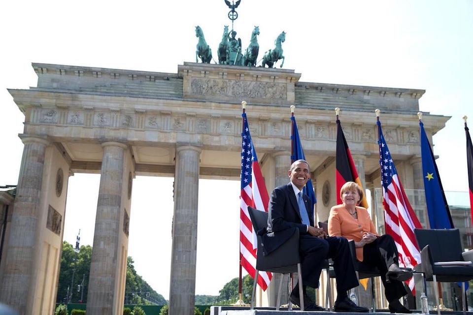Hussein Obama and Merkel at the Brandenburg Gate in 2013