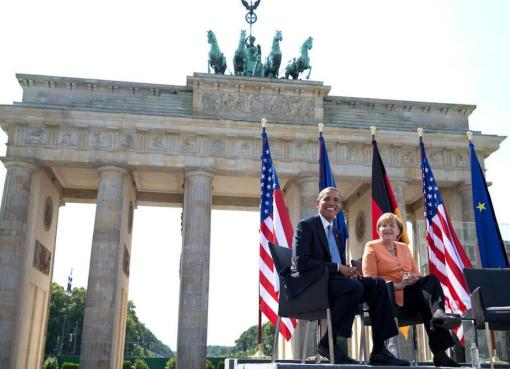 Hussein Obama and Merkel at the Brandenburg Gate in 2013