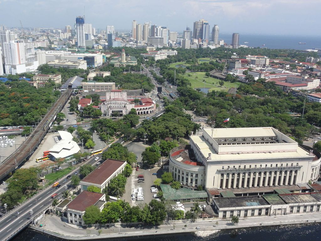 The skyline of Manila with the Manila Central Post Office on the foreground