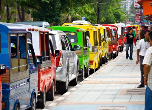 Row of Tuk-Tuks on Thawiwong Road in Patong Beach, Phuket