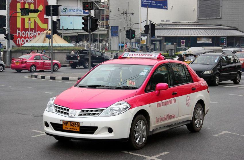 Old Nissan Tiida taxi-meter in Bangkok