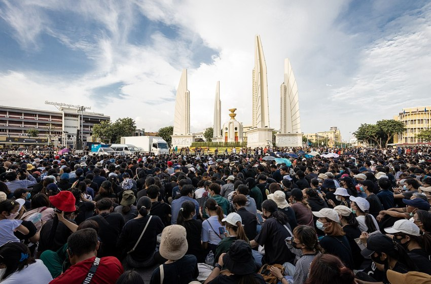 Demonstrators shrug off police warning, rally at Democracy Monument