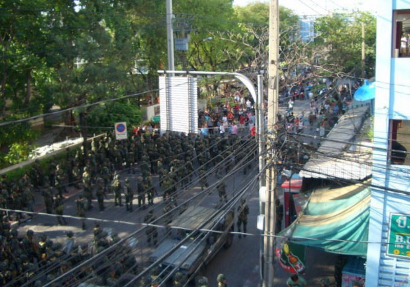 Protesters clash with riot police and military
