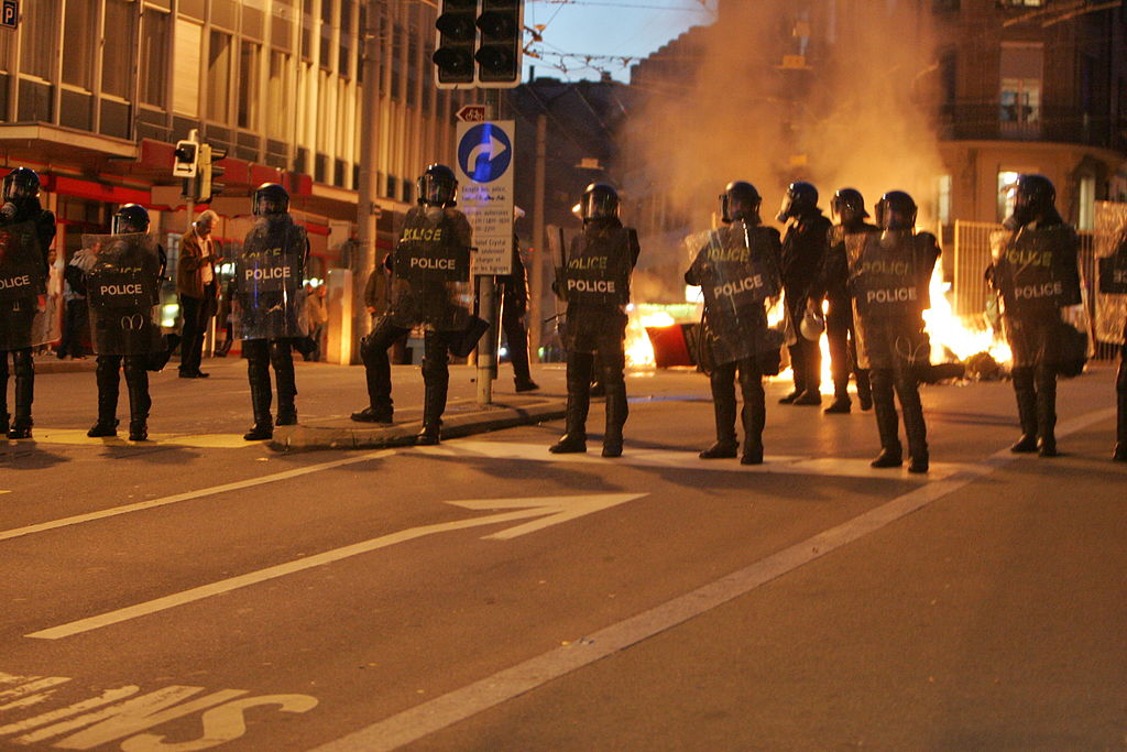 Policemen in riot control gear operating in Lausanne