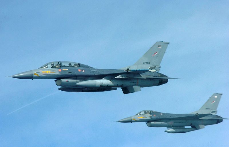 Two Royal Thai Air Force F-16 aircraft fly in formation