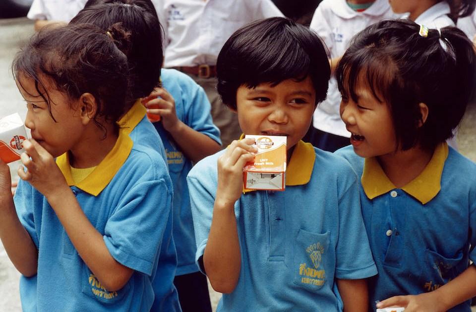 Children drinking milk at kindergarten