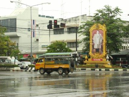 Portrait of King Bhumibol Adulyadej and a songthaew (baht bus) in Kanchanaburi