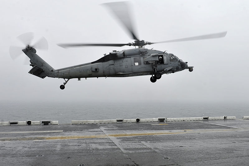 U.S. Navy helicopter landing on a ship after Sewol rescue operation