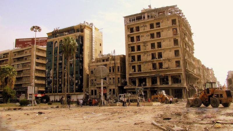Churches burnt, cemeteries desecrated: RT visits liberated Christian city of Al-Qaryatayn, Syria