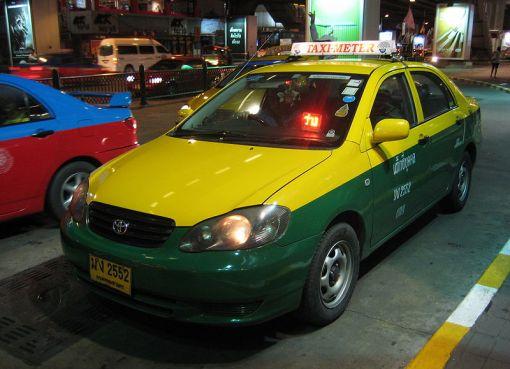Toyota Corolla Altis yellow taxi in Bangkok