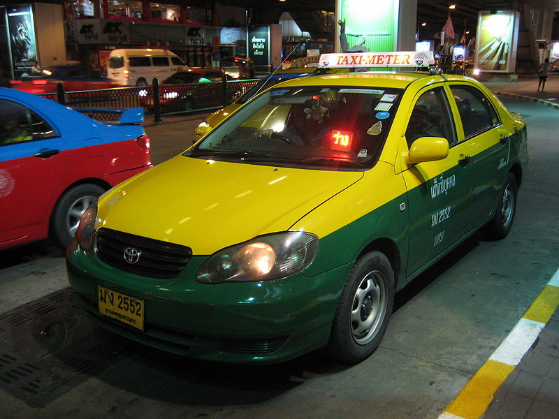 Toyota Corolla Altis yellow taxi in Bangkok