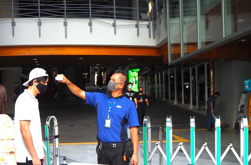 Temperature check point at Siam Square One shopping mall in Bangkok