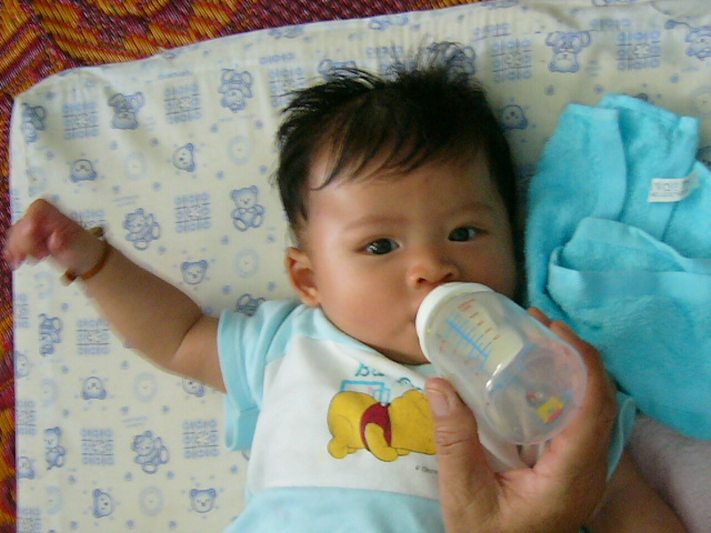 5 months old Thai baby boy sucking milk