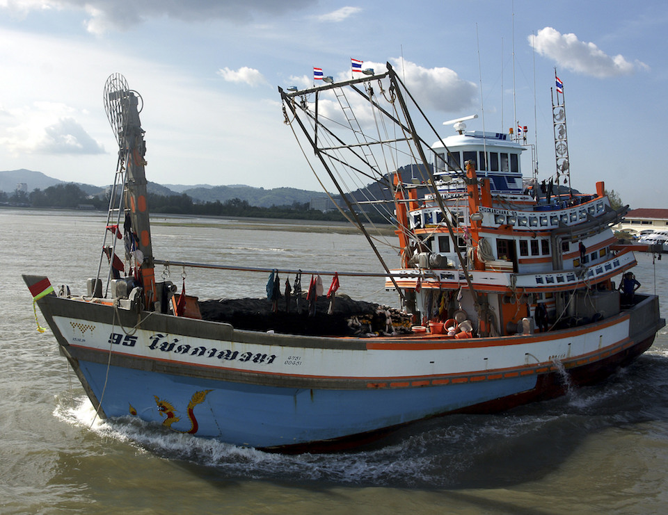 Thai fishing boat leaving Phuket harbour