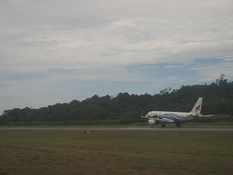 Aircraft taking off at Phuket international airport runway