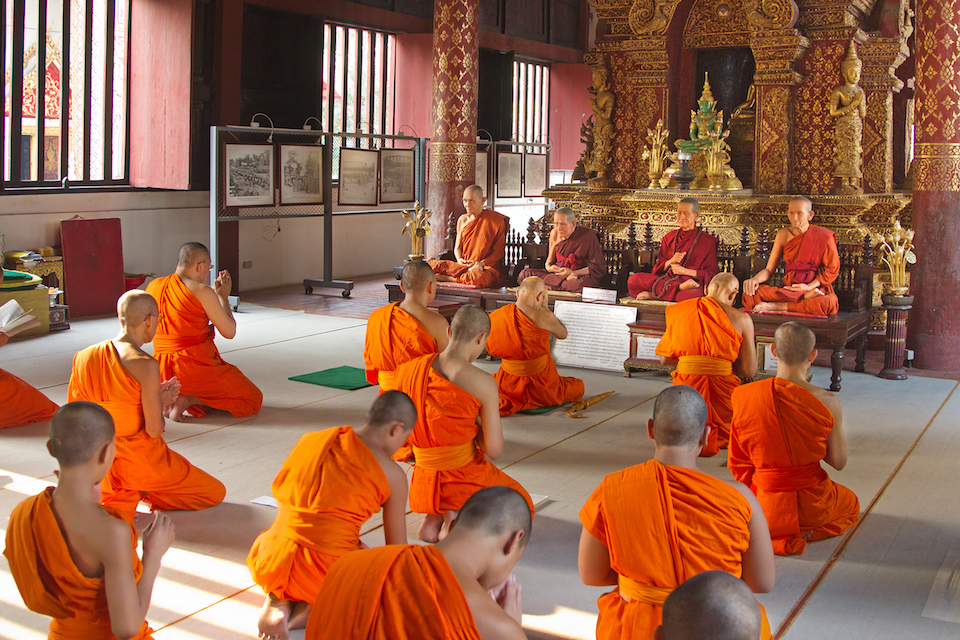 Buddhist monks in the ubosot of Wat Phra Singh, Chiang Mai