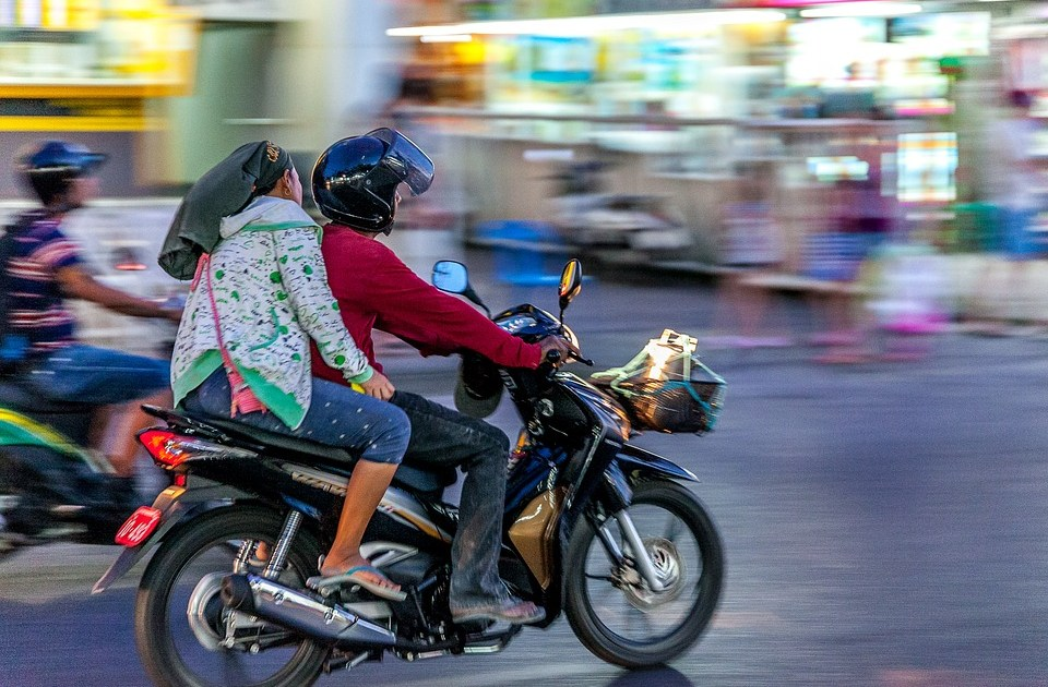 Couple riding a motorcycle in Thailand