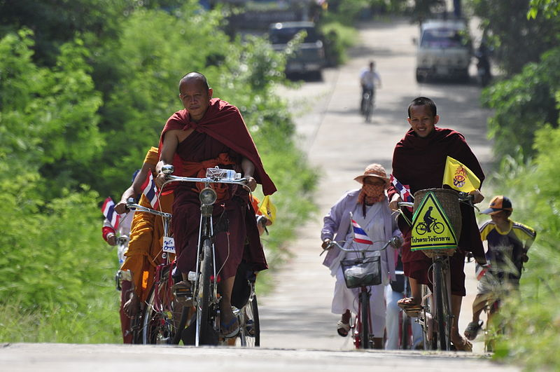 Thai Monks riding bicycles