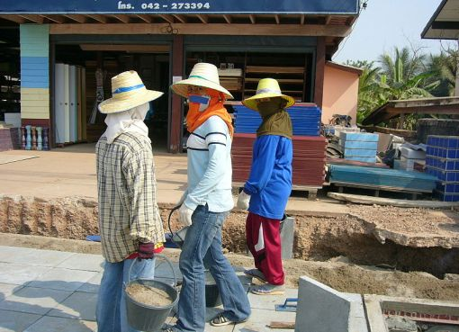 Women working on construction site in Isan