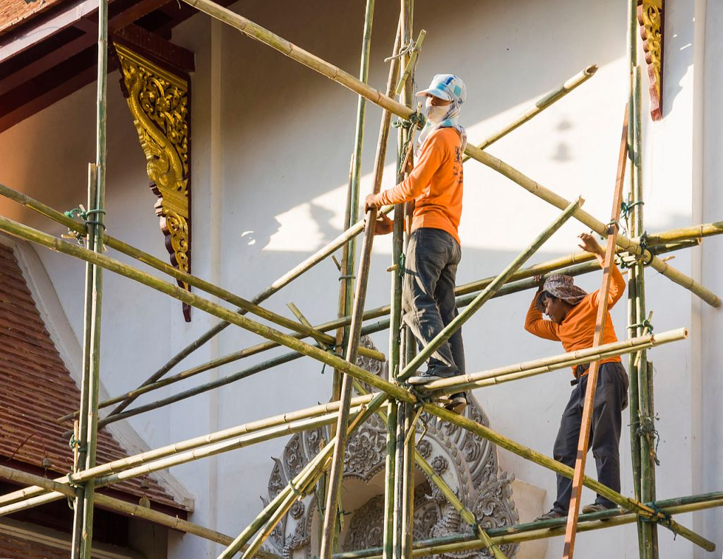 Workers on a bamboo scaffolding during renovation work at Wat Saen Muang Ma Luang in Chiang Ma