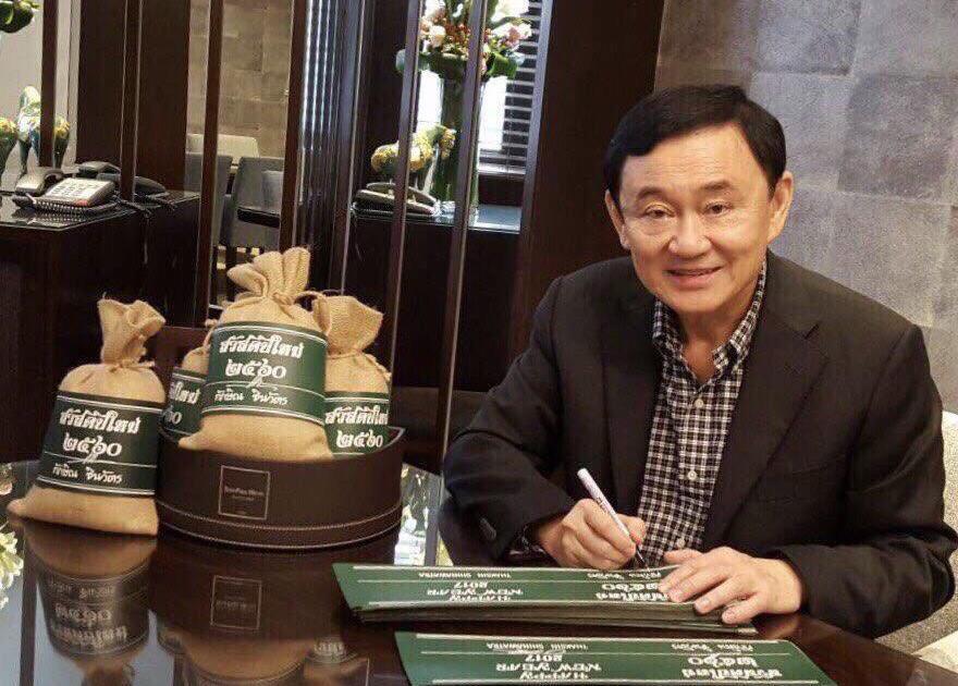 Former Thai PM Thaksin Shinawatra showing Thai rice bags