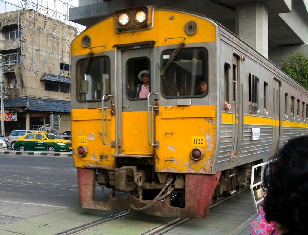 Train crossing Asok-Din Daeng Road at Makkasan Station. The Airport Link trains run above