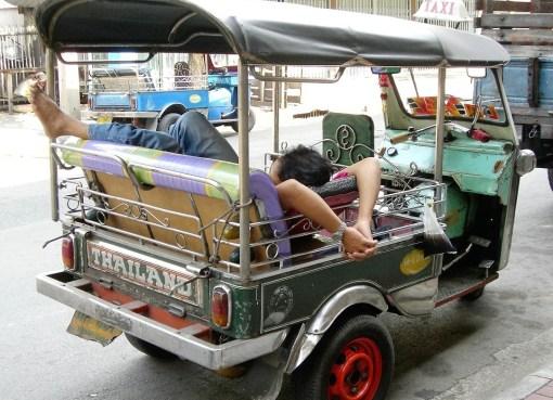 Tuk tuk driver sleeping