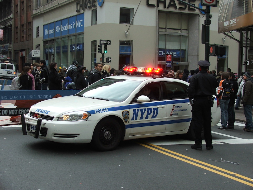 Policemen and NYPD New York police car
