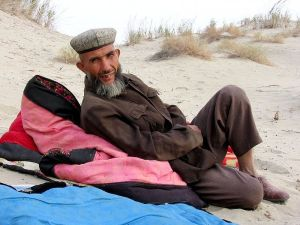 Uyghur camel guide in Taklamakan desert near Yarkand, autonomous region of Xinjiang, China