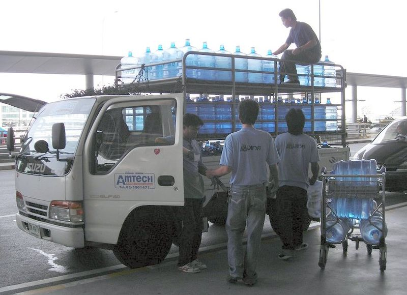 Isuzu ELF 150 with water bottles